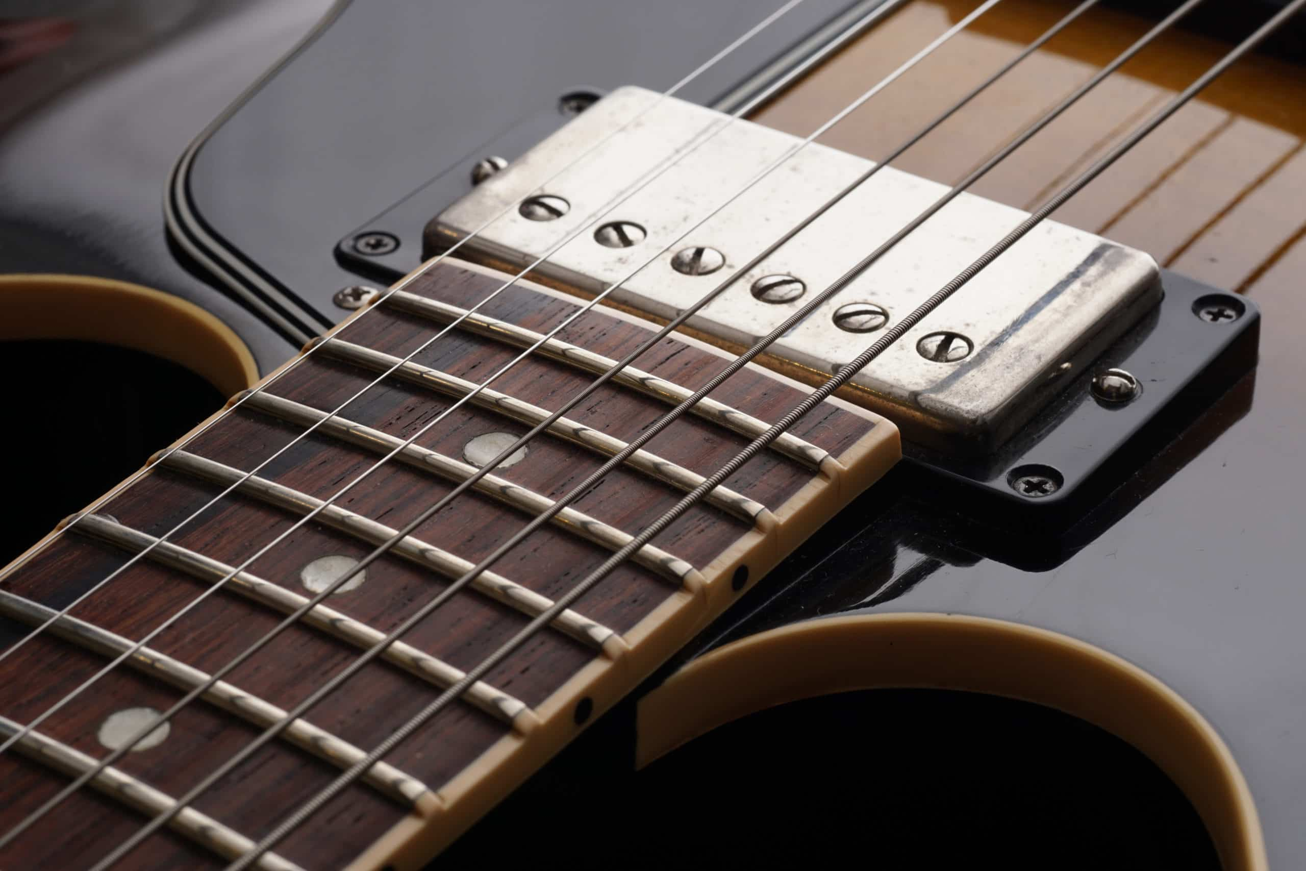 Closeup of old six-string electric guitar