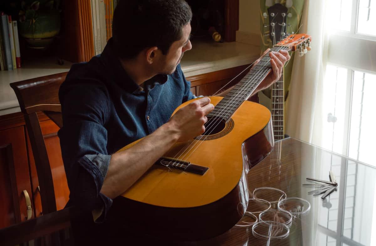 a man changing guitar strings